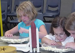 Students examining parts of the shuttle.