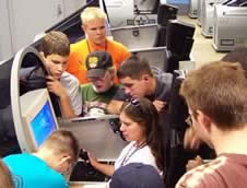 Students gathered around a jet simulator.
