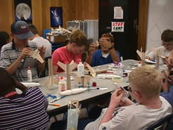 students assembling rockets